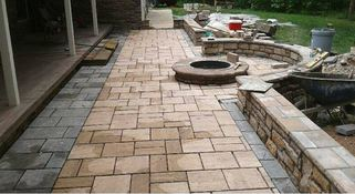 stamped-patio-with-a-firepit-being-intalled-in-indy